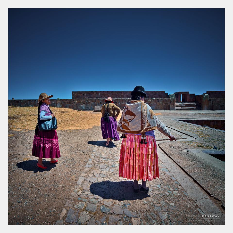 Three women, Tiwanaku Ruins, Altiplano, Bolivia